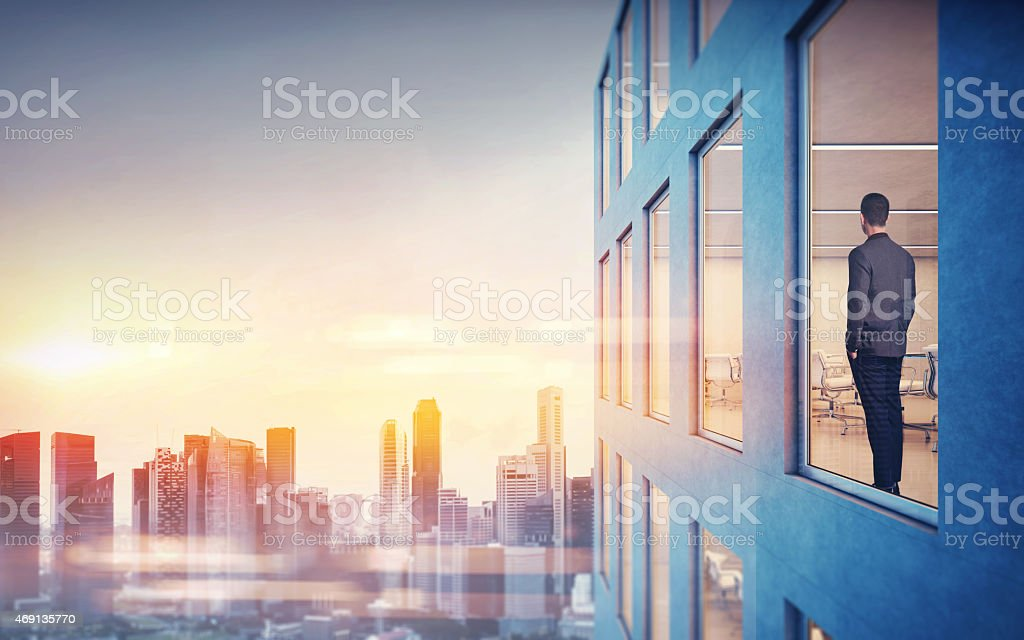 Businessman is looking at city stock photo