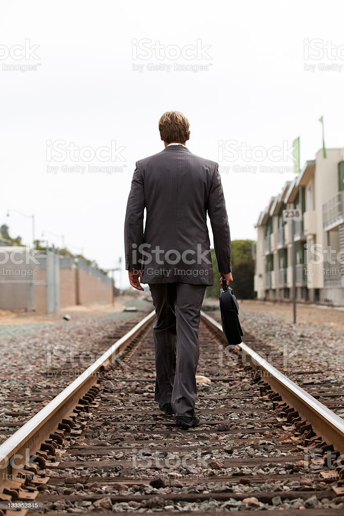 Businessman is on the road stock photo