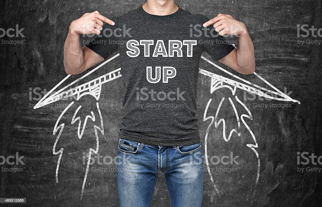 businessman is pointing in ' start up ' stock photo