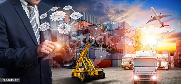 istock Businessman is pressing button on touch screen interface in front for Logistic Import Export background 800998062