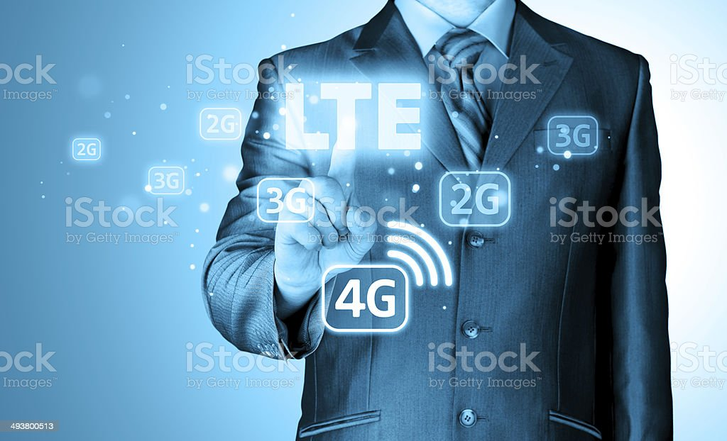 businessman is pushing his finger on lte button stock photo