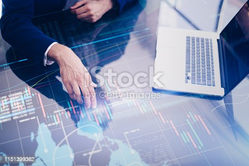 960164282 istock photo Businessman is researching fresh financial analytics on a screen of modern hi tech digital tablet. Male hands with futuristic device 1151399362