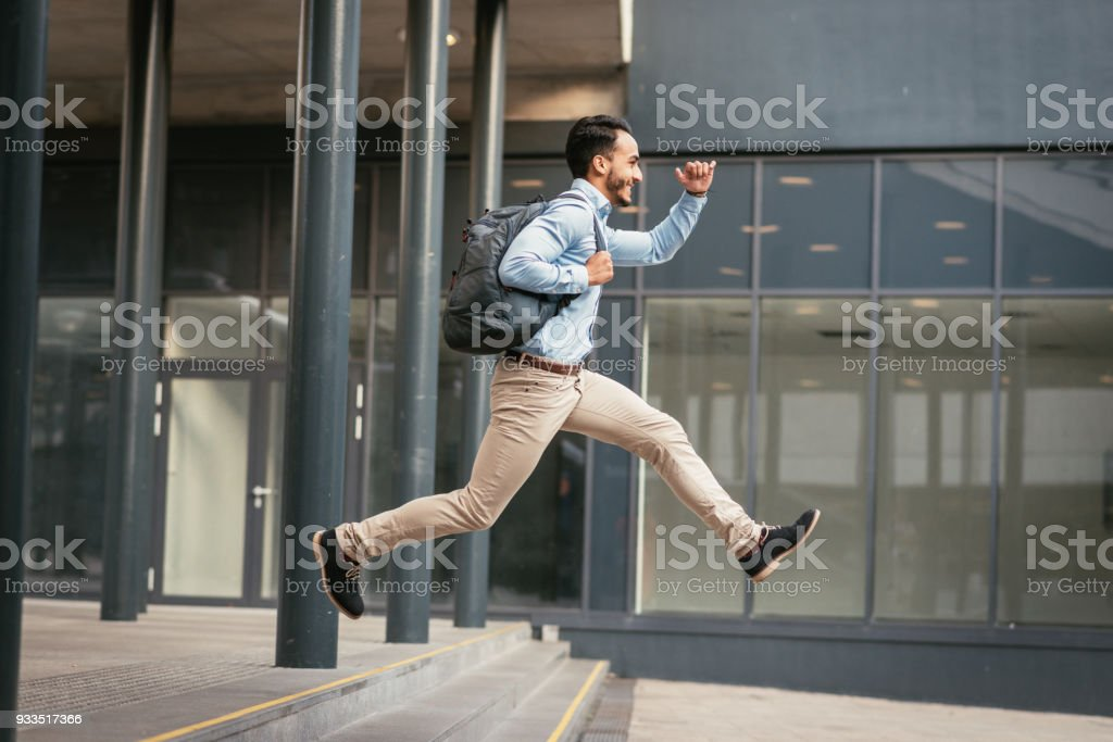 Businessman is running to catch the train stock photo