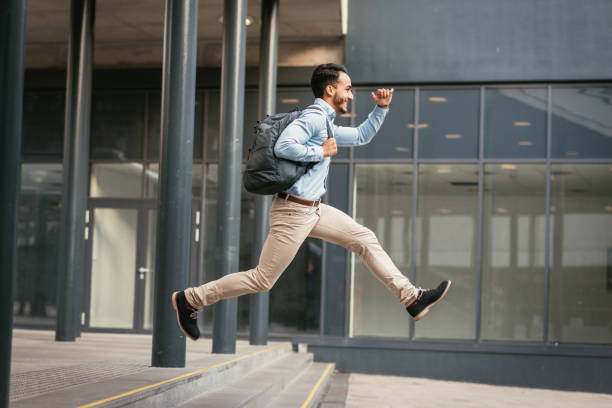 businessman is running to catch the train - urgency stock photos and pictures