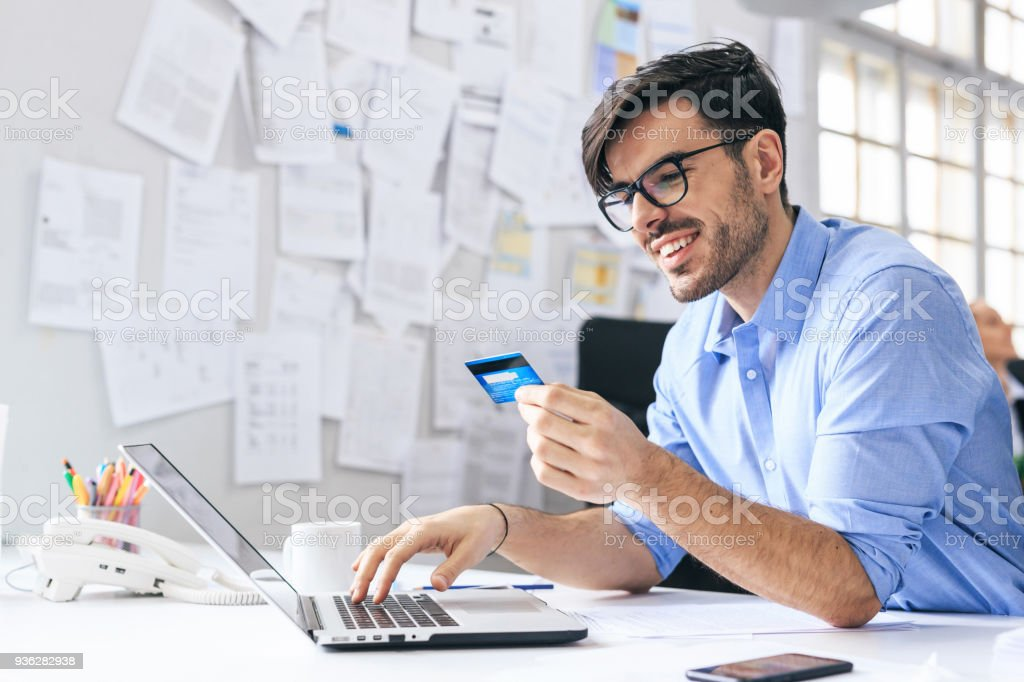 Businessman is shopping online stock photo