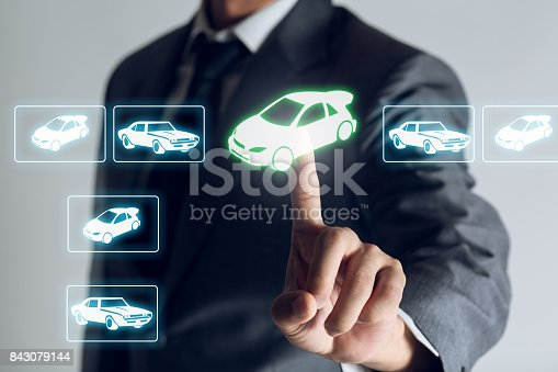 istock Businessman is shopping online to choose a cars to buy about internet of thing concept, Business background. 843079144