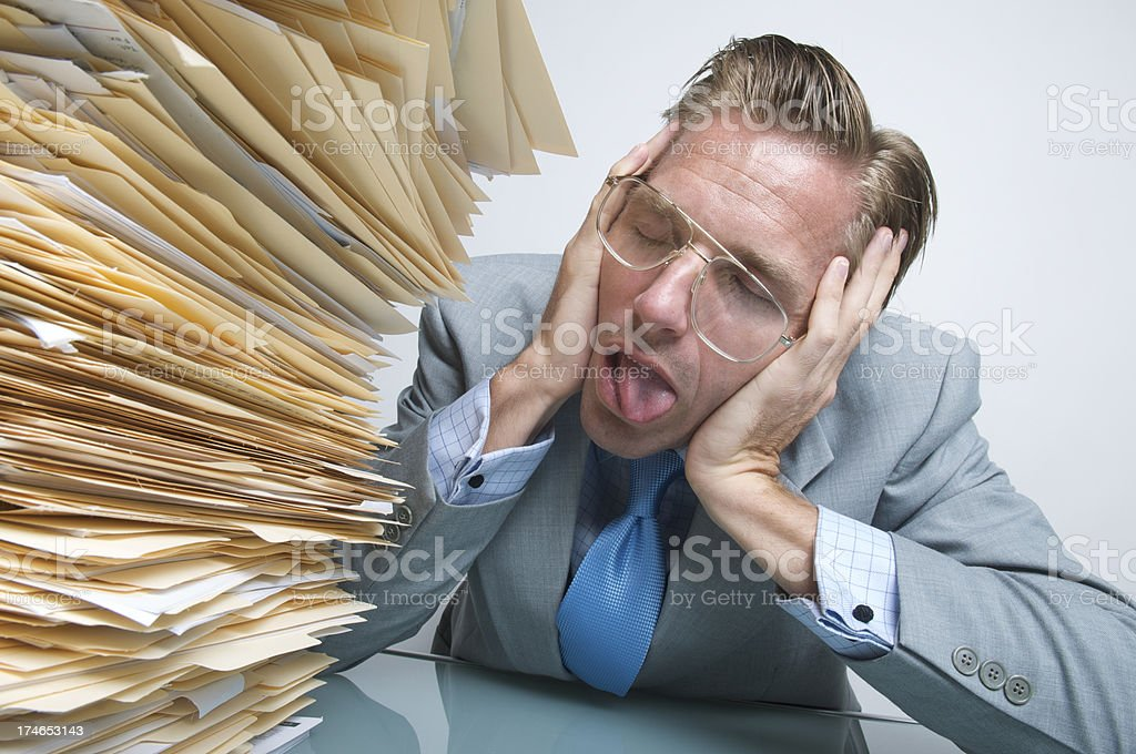 Businessman is Sick and Tired of Work Next to Inbox royalty-free stock photo