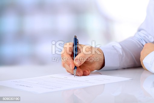 istock Businessman is signing a contract, business contract details 509030190