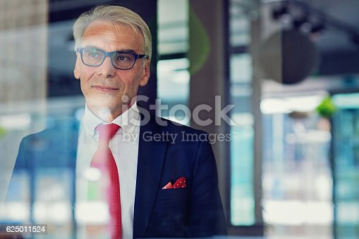 istock Businessman is standing in his office 625011524