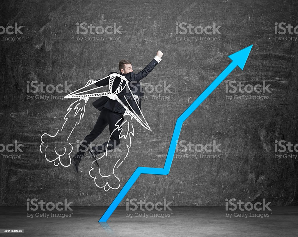 Businessman is taking of to the success with drawn wings. stock photo