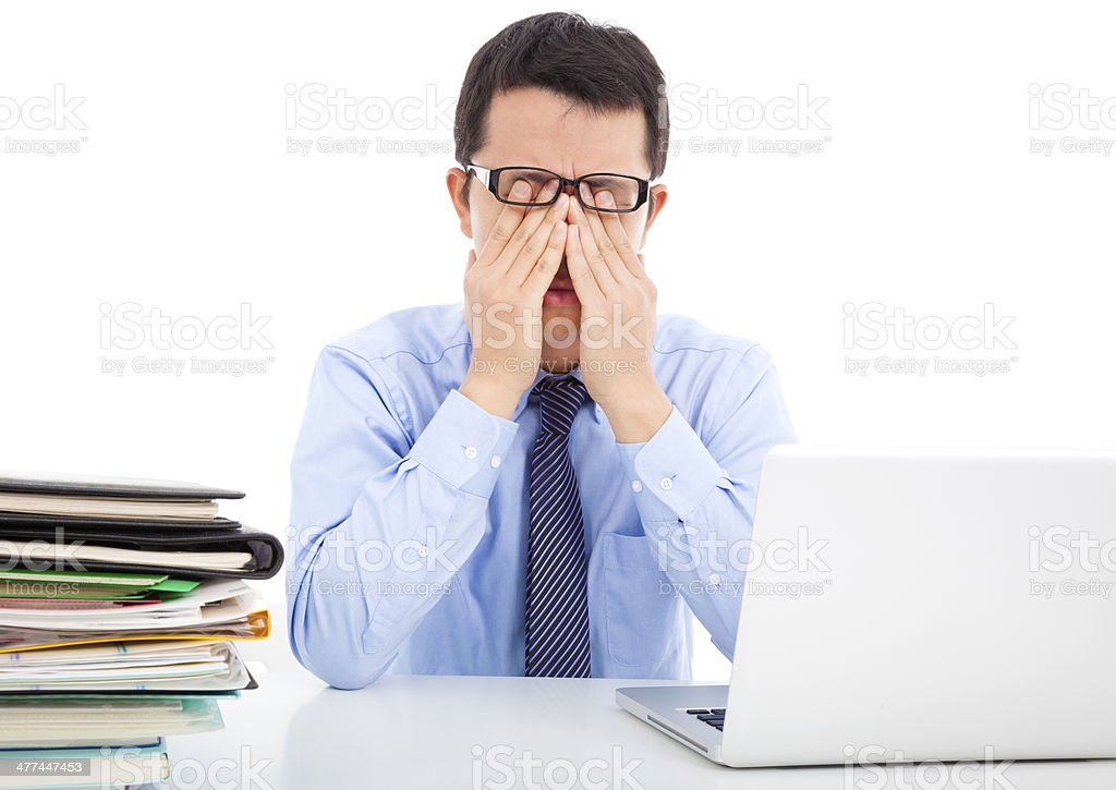 businessman is too fatigued to rubbing his eyes stock photo