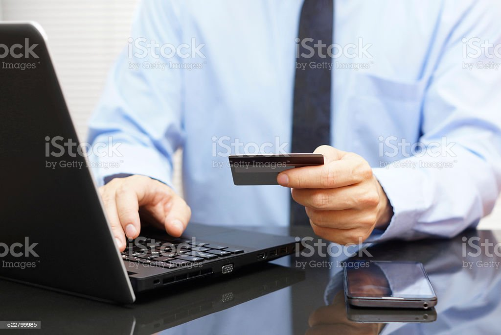 Businessman is using credit card for on line payment stock photo