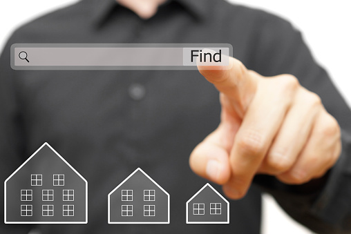 istock businessman is using internet search bar to  find real estate 494388740