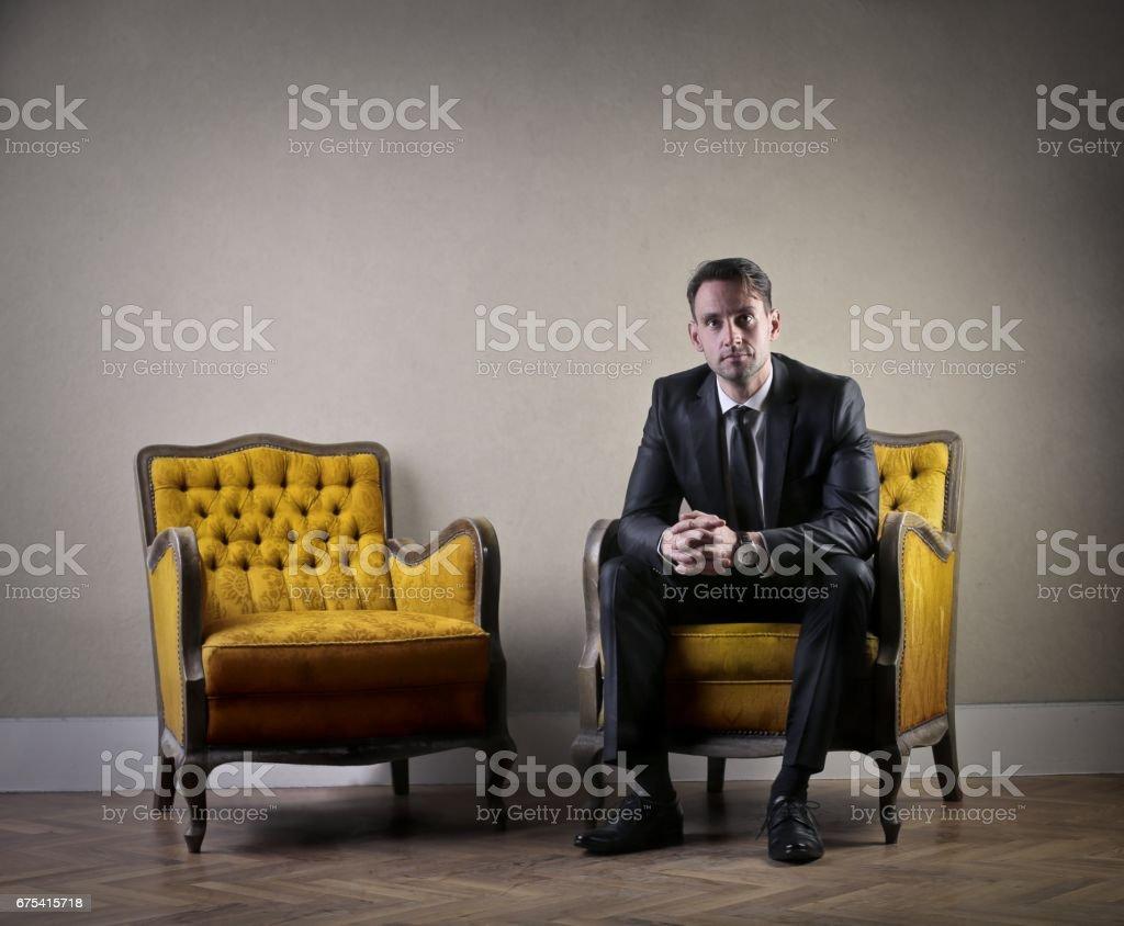 Homme d'affaires est en attente photo libre de droits