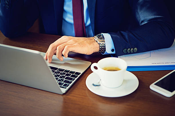Businessman is working using his laptop – Foto