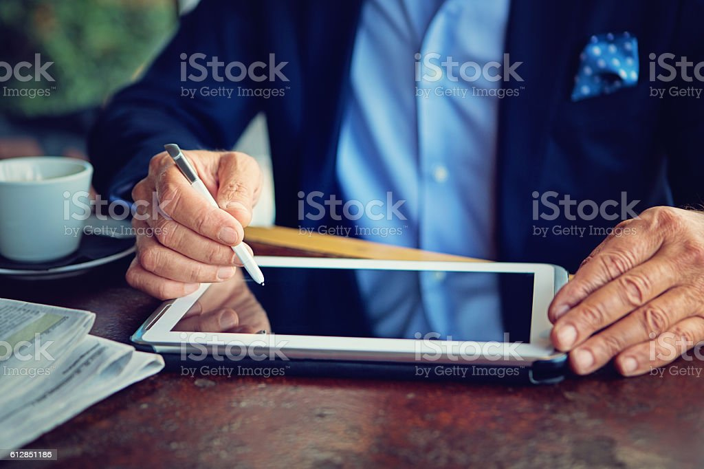 Businessman is working using his tablet stock photo