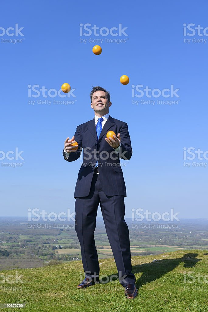 Businessman Juggler stock photo