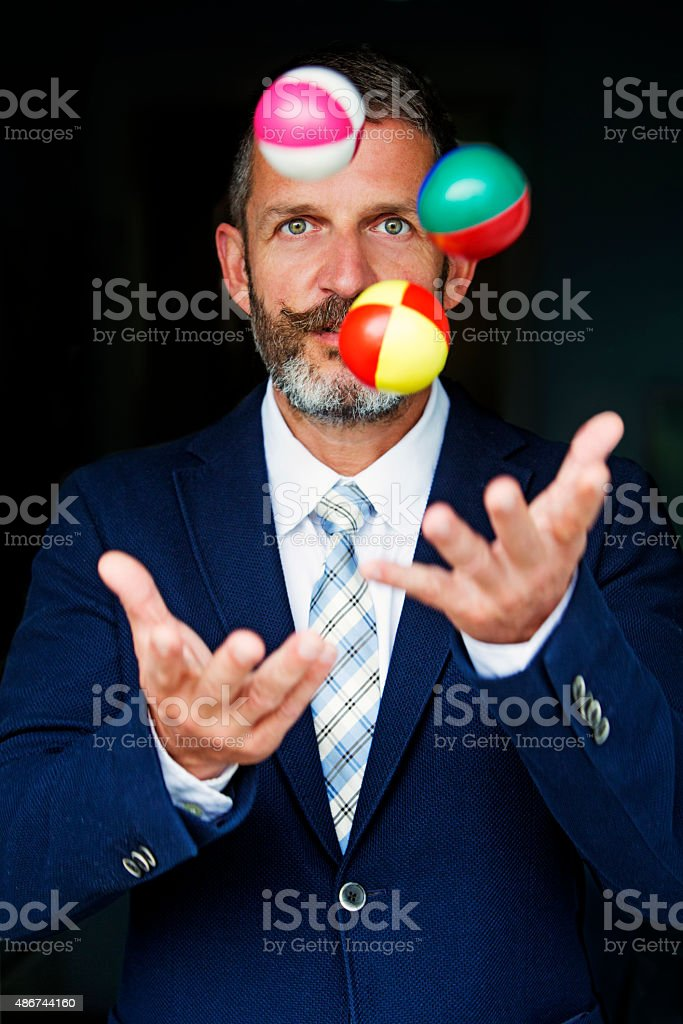 businessman juggles balls stock photo
