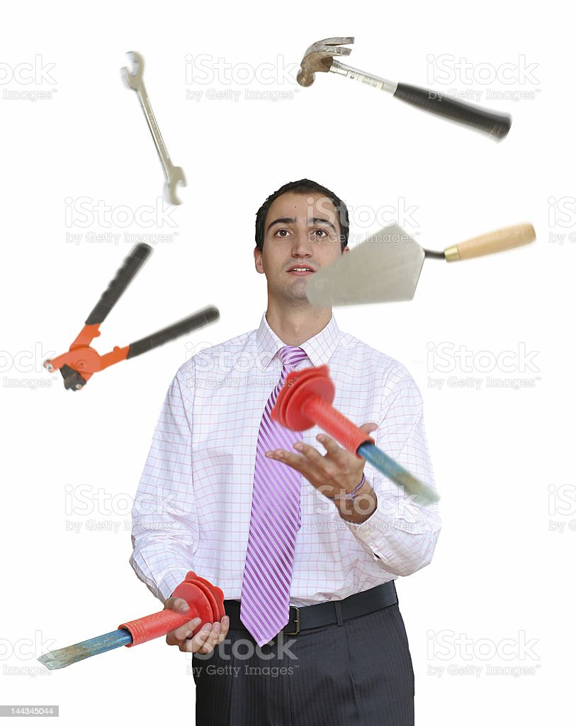 Businessman juggling hand tools stock photo
