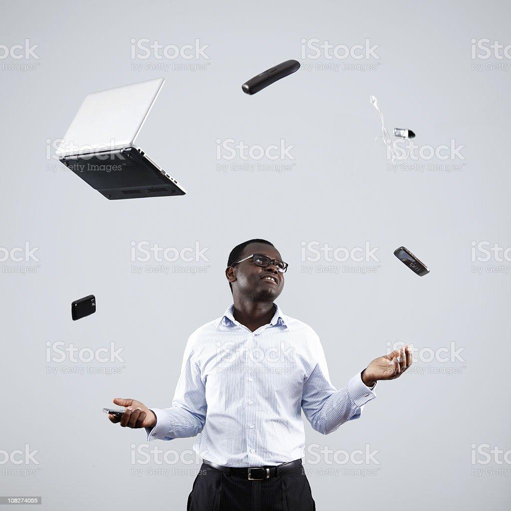 Businessman Juggling Technology royalty-free stock photo