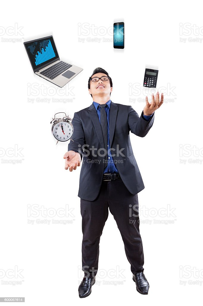 Businessman juggling with business items stock photo