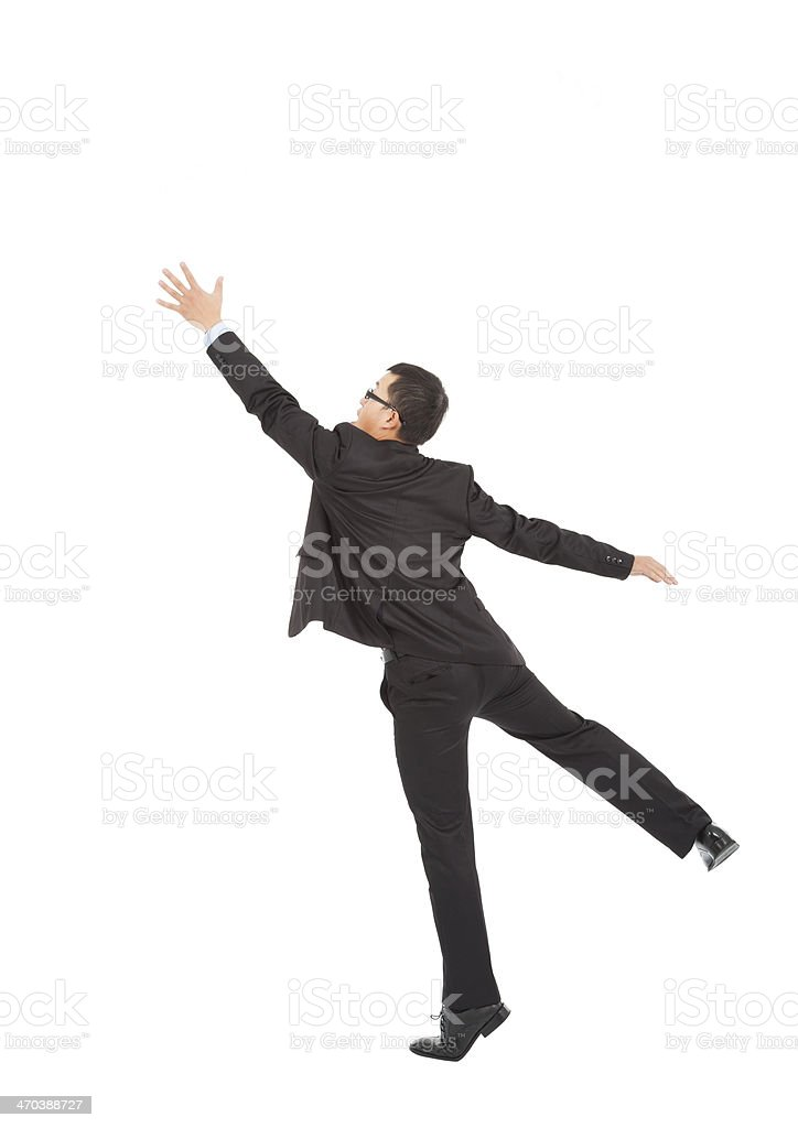 businessman jumping and grabbing over white background stock photo