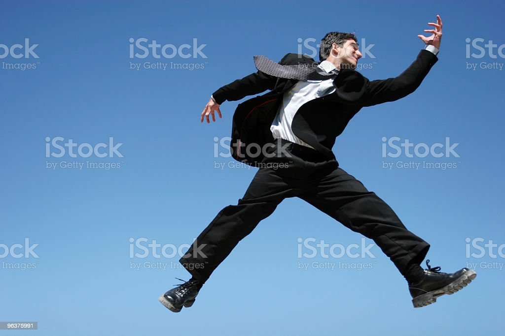 Businessman jumping for success royalty-free stock photo