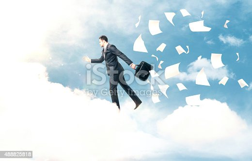 istock businessman jumping from cloud 488825818