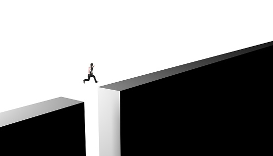 Businessman jumping from obstacles of life