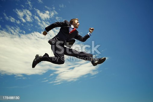 istock Businessman Jumping High Outdoors in Blue Sky with Clouds 175488130