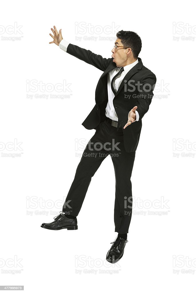 Businessman jumping in excitement royalty-free stock photo