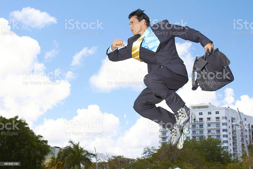 Businessman Jumping In Rollerblades royalty-free stock photo