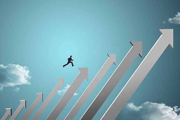 businessman jumping on growing chart with sky background businessman jumping on growing chart with sky background high up stock pictures, royalty-free photos & images
