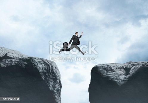 istock businessman jumping 452266423