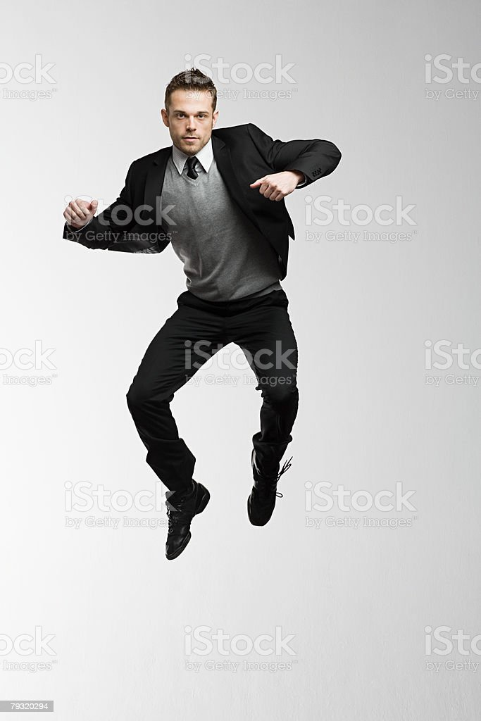 A businessman jumping stock photo