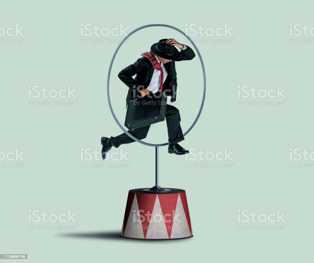 Businessman Jumping Through A Hoop stock photo
