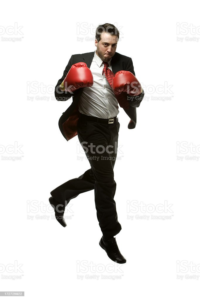 Businessman jumping with red boxing gloves. royalty-free stock photo