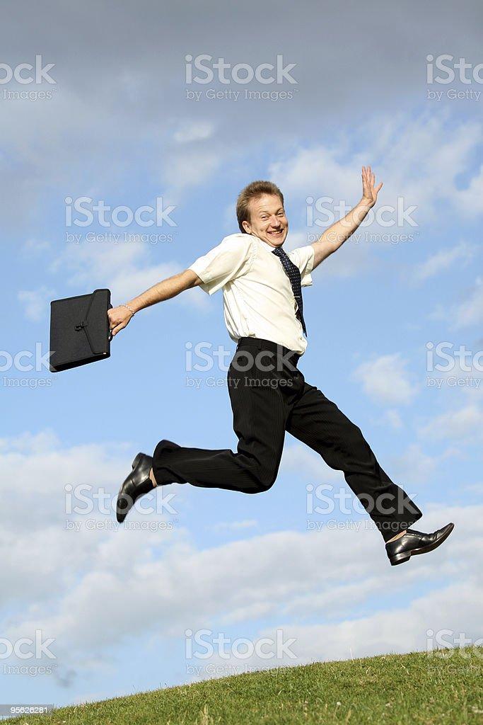 businessman jumps royalty-free stock photo