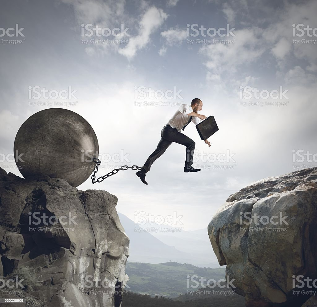 Businessman jumps the obstacle stock photo