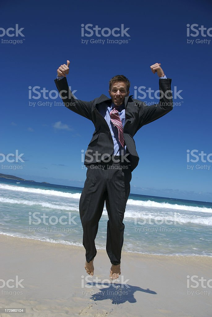 Businessman Jumps with Thumbs Up royalty-free stock photo