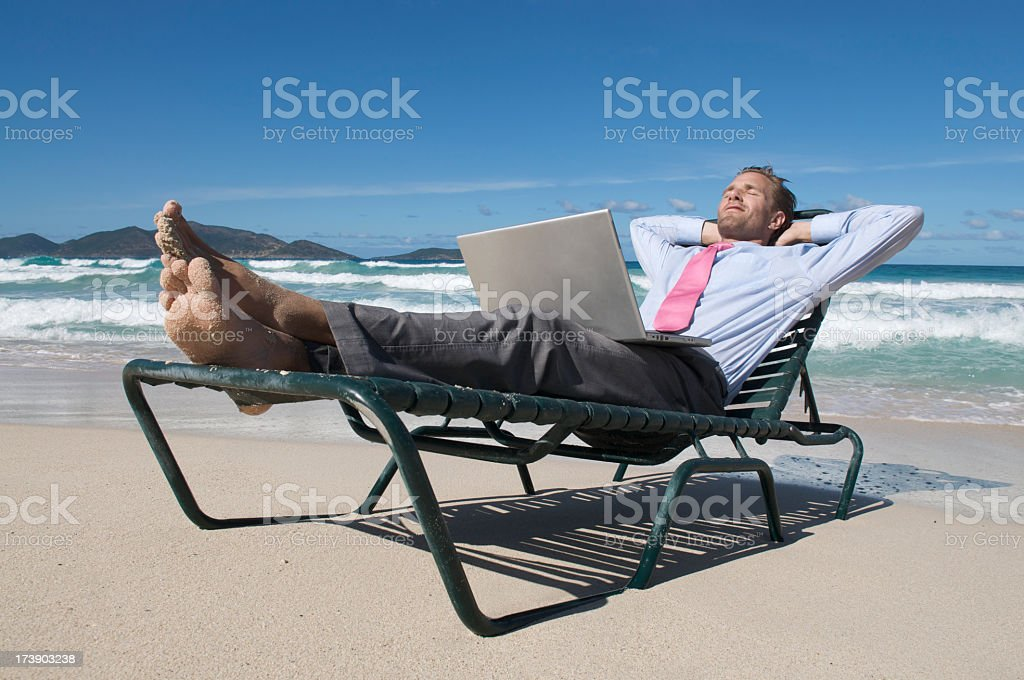 Businessman Kicks Back on Beach Chair royalty-free stock photo