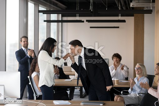 1070271598 istock photo Businessman kissing the hand of asian girl during business meeting 1092087722