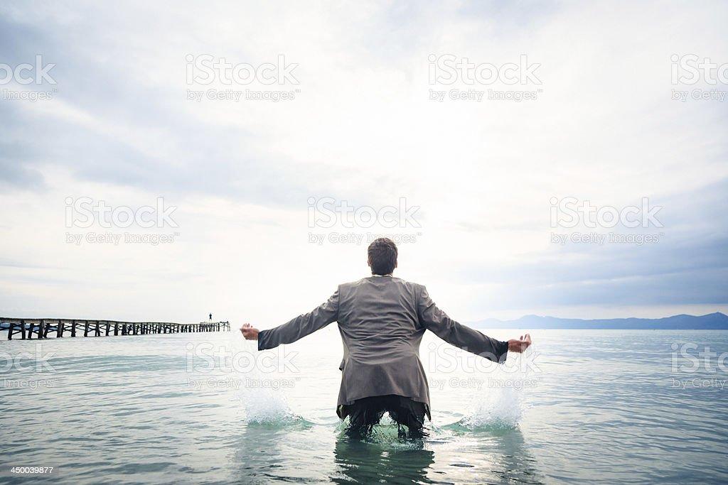 businessman knee-deep in water stock photo