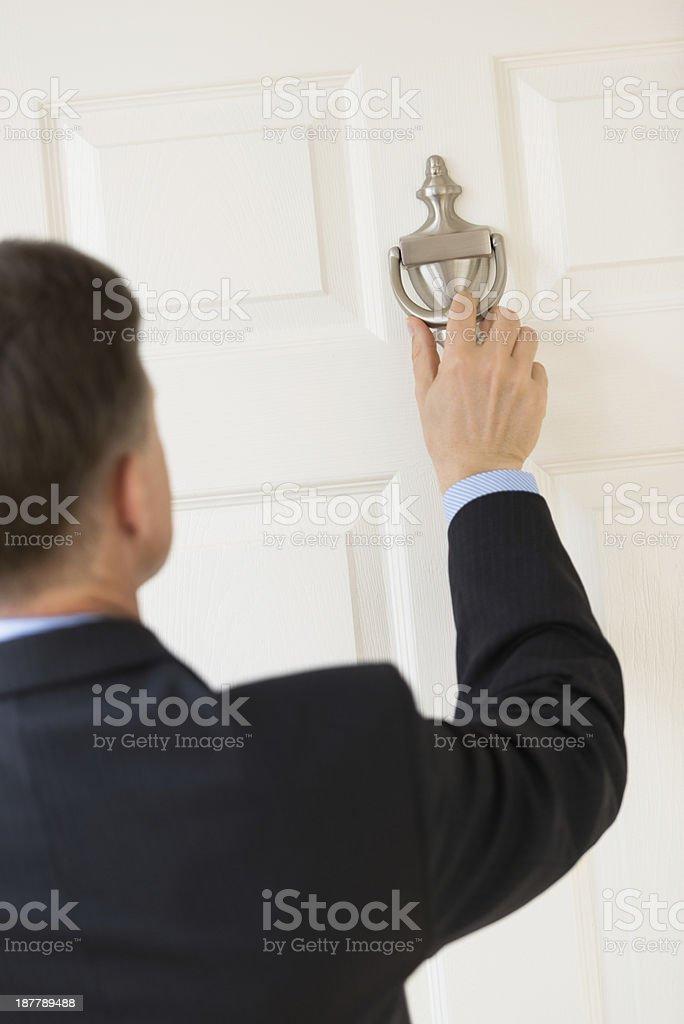 Businessman Knocking Door Handle stock photo
