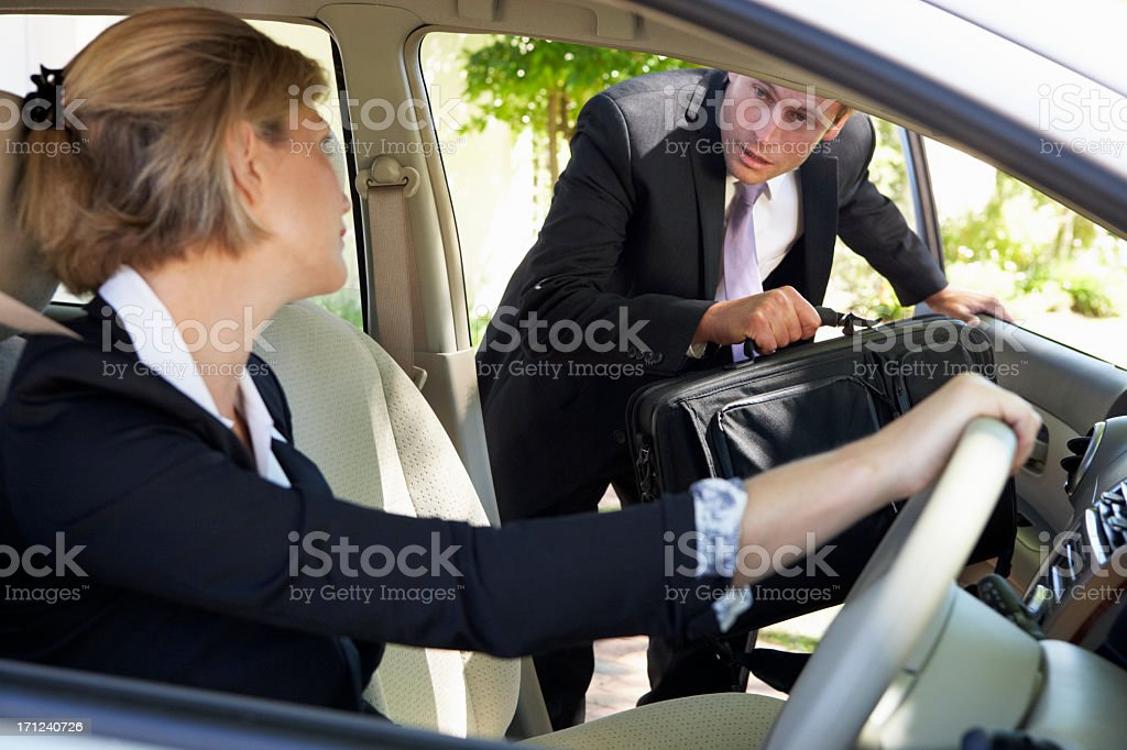 Businessman Late For Car Pooling Journey stock photo