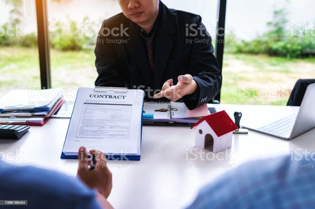 Businessman Lawyer Explain The Documents Contact At Office Desk Home
