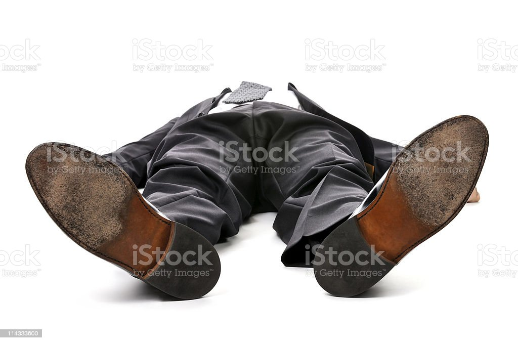 Businessman laying down on white background stock photo