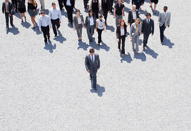 Businessman leading business people stock photo
