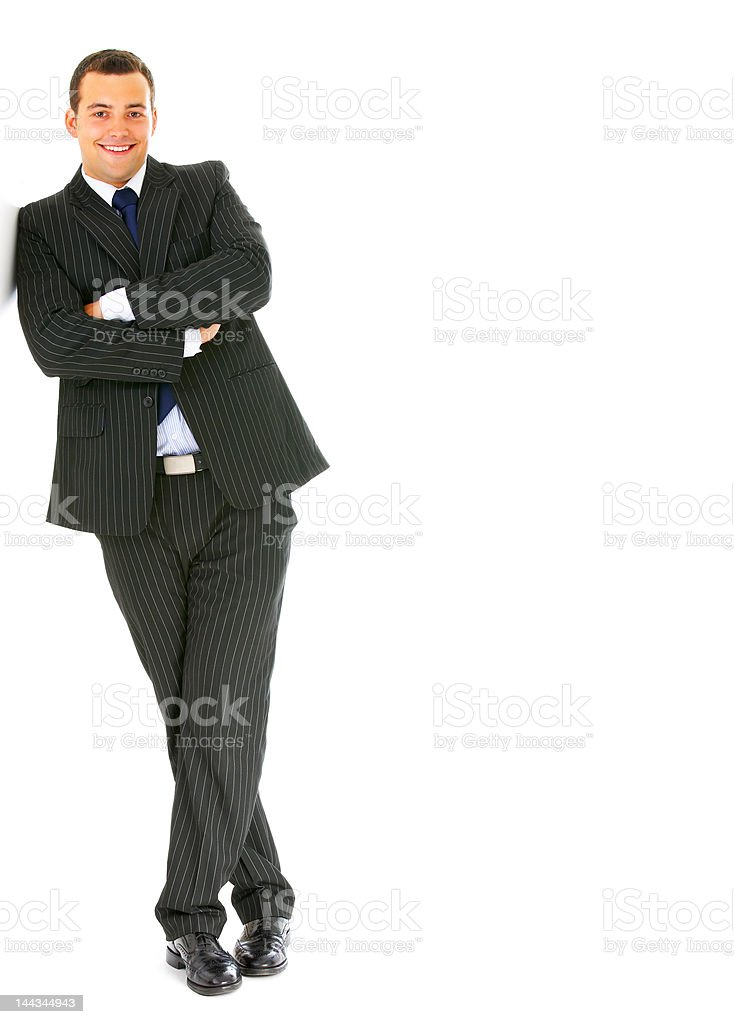 Businessman leaning and smiling royalty-free stock photo