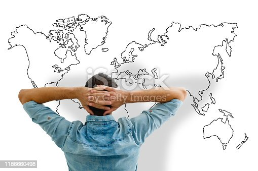 istock Businessman leaning back looking at world map 1186660498